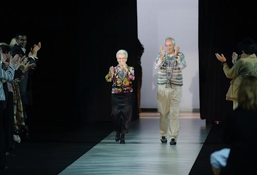 FILE - In this Oct. 2003 file photo Rosita, left, and Ottavio Missoni take the catwalk after presenting their Spring/Summer 2004 fashion collection, in Milan, Italy. Italian fashion company Missoni says its co-founder, Ottavio Missoni, has died in his home earlier on Thursday, May 9, 2013 in northern Italy. Missoni, who was 92, founded the iconic fashion brand of zigzagged-patterned knitwear along with his wife, Rosita, in 1953. The Missonis are a family fashion dynasty, with the couple's children and their offspring involved in expanding the brand. (AP Photo/Antonio Calanni, File)
