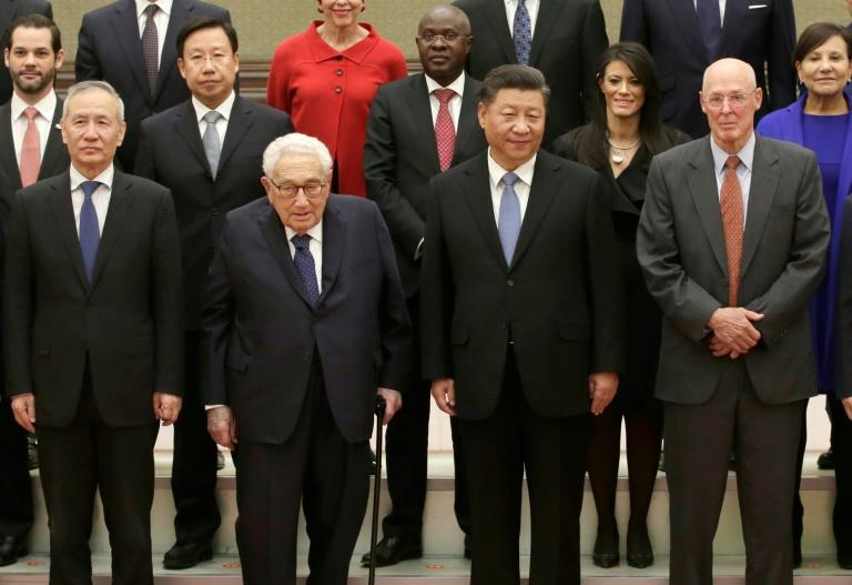 China's President Xi Jinping (2nd R), Vice Premier Liu He (L), former US Secretary of State Henry Kissinger (2nd L), former US Treasury Secretary Henry Paulson (R) and other members of a delegation
