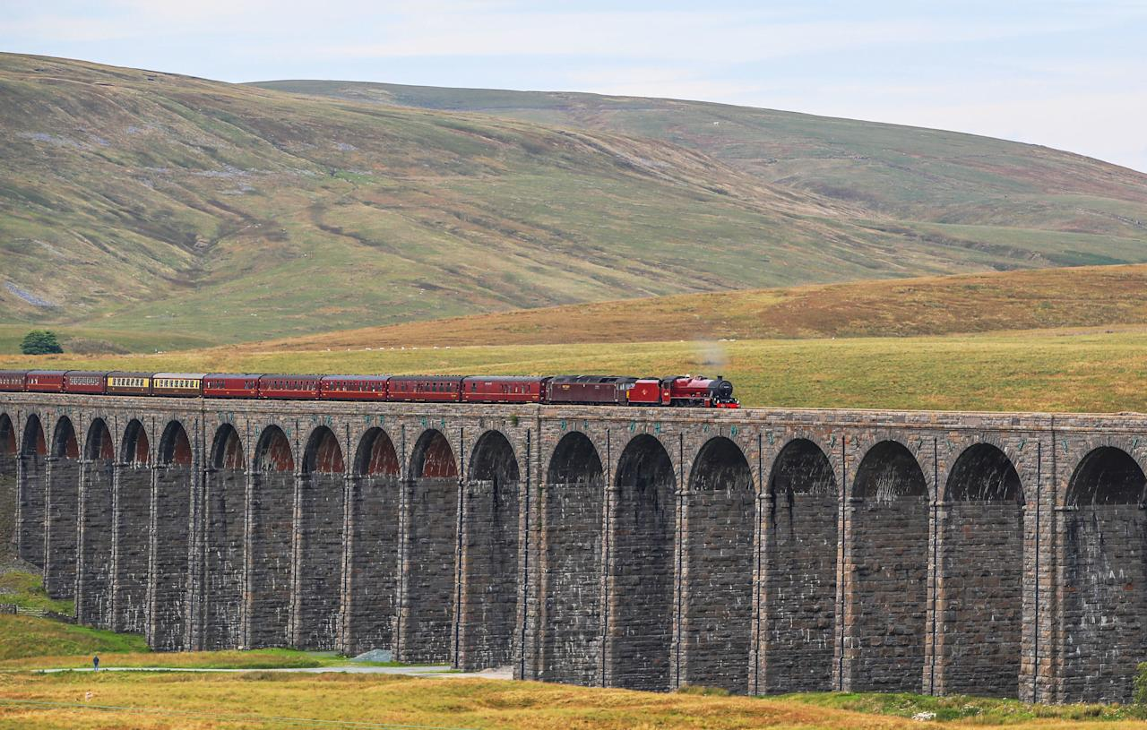 <p>The Cumbrian Mountain Express, pulled by historic steam locomotive No 45699 Galatea, crosses the Ribblehead Viaduct in North Yorkshire as railway enthusiasts mark the 50th anniversary of the end of regular mainline steam services. (PA) </p>
