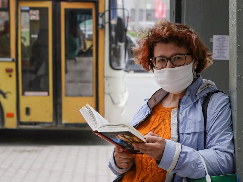 NOVOSIBIRSK, RUSSIA - APRIL 29, 2020: A woman wears a face mask amid the ongoing COVID-19 pandemic; the Russian President has announced extending a paid period off work until May 11 nationwide to counter the spread of the COVID-19 infection. Kirill Kukhmar/TASS (Photo by Kirill Kukhmar\TASS via Getty Images)