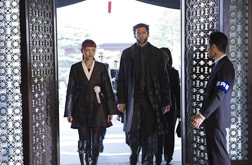 """This publicity image released by 20th Century Fox shows Rila Fukushima, left, and Hugh Jackman in a scene from """"The Wolverine."""" (AP Photo/20th Century Fox, Ben Rothstein)"""