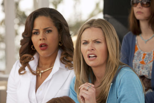 "This publicity image released by ABC shows Lenora Crichlow, left, and Maggie Lawson in a scene from ""Back in the Game,"" a new comedy premiering Wednesday, Sept. 25 at 8:30 p.m. EST. (AP Photo/ABC, Randy Holmes)"
