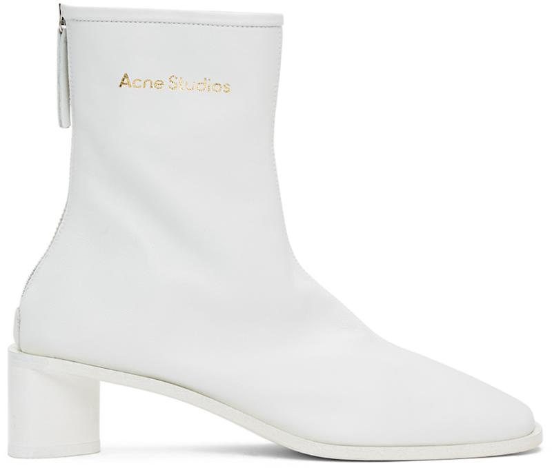 Acne Studios White Branded Heeled Boots. Image via SSENSE.