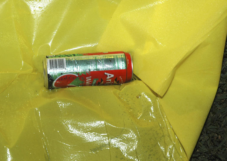 This Feb. 26, 2012 photo released by the State Attorney's Office shows a can of Arizona Watermelon Fruit Juice Cocktail at the scene where Trayvon Martin was shot by neighborhood watch volunteer George Zimmerman. The photo and reports were among evidence released by prosecutors that also includes calls to police, video and numerous other documents. The package was received by defense lawyers earlier this week and released to the media on Thursday. (AP Photo/State Attorney's Office)