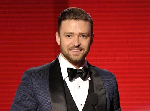 """FILE - In this Nov. 24, 2013 file photo, Justin Timberlake accepts the award for favorite album - soul/R&B for """"The 20/20 Experience"""" at the American Music Awards in Los Angeles. In the Coen brothers' """"Inside Llewyn Davis"""" Timberlake plays a supporting role as a cheery, sweater-wearing 1960s folk musician. But he also collaborated with producer T Bone Burnett on the movie's memorable period songs and helped shape the film's most unforgettable and comic tune, """"Please Mr. Kennedy."""" (Photo by John Shearer/Invision/AP, File)"""