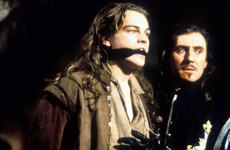 Leonardo DiCaprio with his mouth covered next to Gabriel Byrne in a scene from the film 'The Man In The Iron Mask', 1998. (Photo by United Artists/Getty Images)