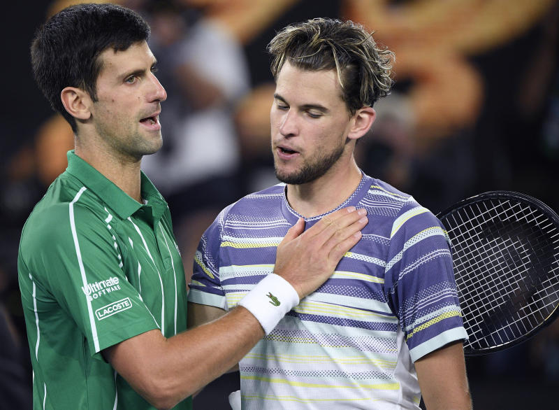 Serbia's Novak Djokovic, left, is congratulated by Austria's Dominic Thiem after winning the men's singles final at the Australian Open tennis championship in Melbourne, Australia, Sunday, Feb. 2, 2020. (AP Photo/Andy Brownbill)