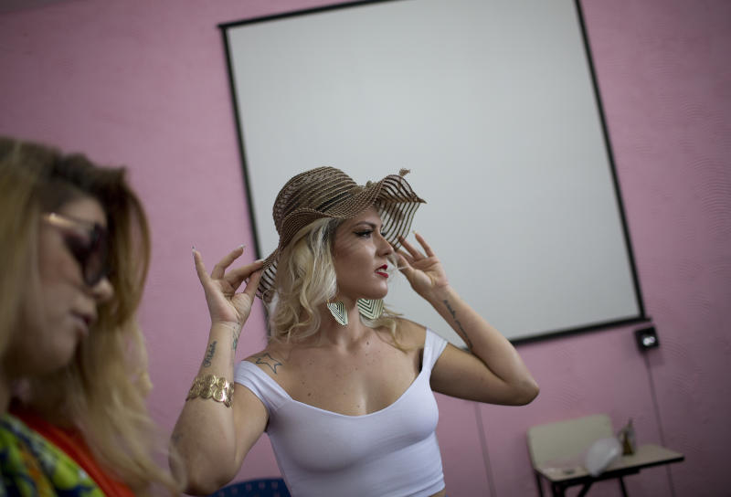 Inmate Veronica Verone, 25, sports a floppy hat as prepares to compete in the 13th annual Miss Talavera Bruce beauty pageant at the penitentiary the pageant is named for, in Rio de Janeiro, Brazil, Tuesday, Dec. 4, 2018. Prison authorities say they organize the annual beauty contest to encourage self-esteem, fight idleness and promote integration among the female inmates. (AP Photo/Silvia Izquierdo)