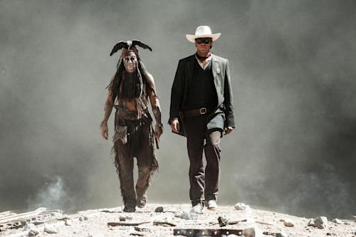 "This undated publicity photo released by Disney and Jerry Bruckheimer, Inc. shows Johnny Depp, left, as Tonto, and Armie Hammer, as The Lone Ranger, in a scene from the film, ""The Lone Ranger."" (AP Photo/Disney/Jerry Bruckheimer, Inc., Peter Mountain, File)"
