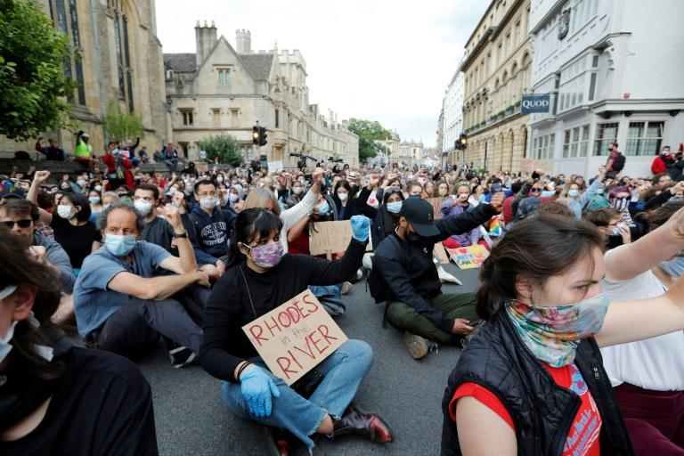 Oxford protesters sat with raised fists for nearly nine minutes in tribute to unarmed black man George Floyd, whose death in US police custody triggered outrage worldwide