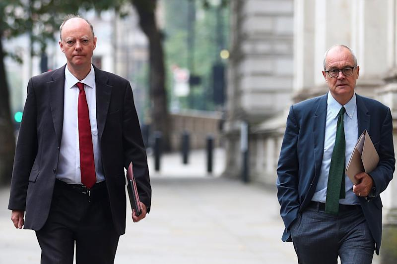 Chris Whitty (left) and Sir Patrick Vallance head to Downing Street (REUTERS)