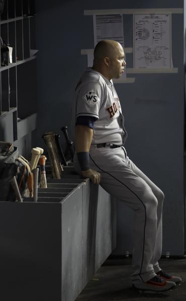 FILE - In this Oct. 24, 2017, file photo, then-Houston Astros' Carlos Beltran waits in the dugout during the sixth inning of Game 1 of baseball's World Series against the Los Angeles Dodgers, in Los Angeles. Beltran is out as manager of the New York Mets. The team announced the move Thursday, Jan. 16, 2020. (AP Photo/David J. Phillip, File)