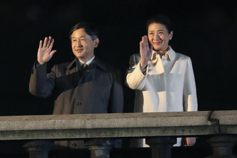 Japanese Emperor Naruhito and Empress Masako wave as they make a public appearance during a ceremony to celebrate his enthronement in Tokyo Saturday, Nov. 9, 2019. Naruhito thanked tens of thousands of well-wishers who gathered outside the palace to congratulate his enthronement at the ceremony organized by conservative political and business groups. (AP Photo/Koji Sasahara, Pool)