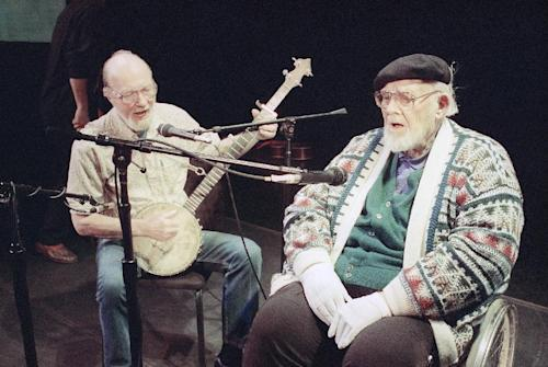 File-This May 1993 file photo shows Pete Seeger, left, age 74, who hadn't sung with Burl Ives, right, age 84, for at least 40 years, singing together in rehearsal at New York's 92nd St., Y. The American troubadour, folk singer and activist Seeger died Monday Jan. 27, 2014, at age 94. (AP Photo/Marty Reichenthal, File)