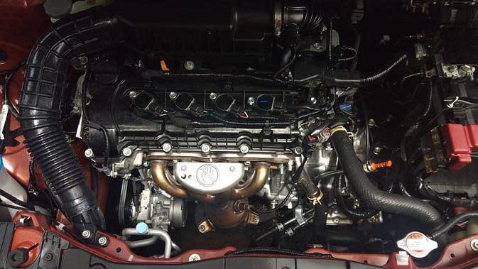 Seperti Suzuki Ertiga, XL7 mengusung mesin K15B berkapasitas 1.5 liter DOHC. (Septian/Liputan6.com)