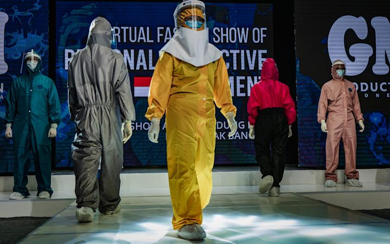 Medical workers showcase designs during the virtual fashion show of PPE - Ulet Ifansati/Getty Images AsiaPac