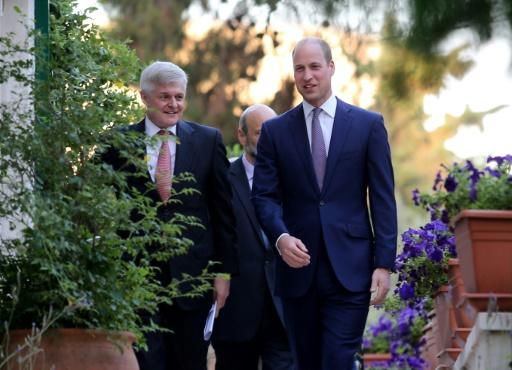 Britain's Prince William attends a birthday party in honour of his grandmother, Queen Elizabeth II, at the residence of the British ambassador Edward Oakden's (L) house in the Jordanian capital Amman on 24 June, 2018