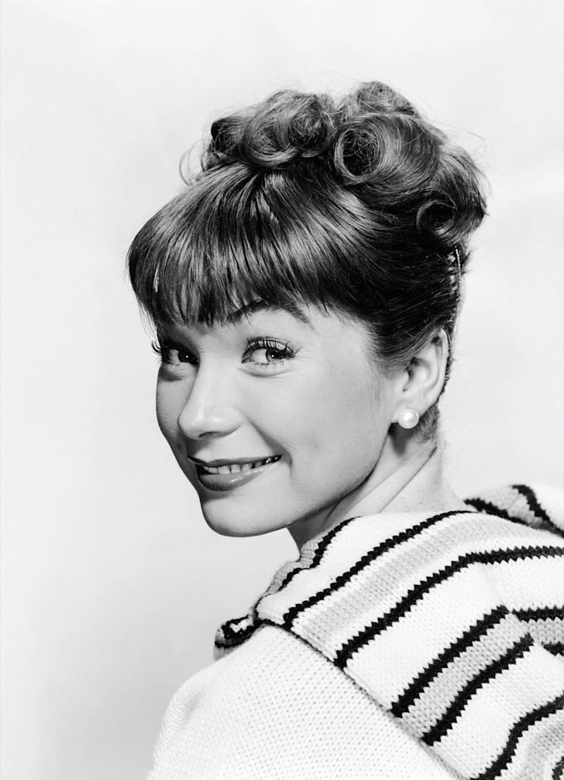 shirley maclaine with an updo and short bangs