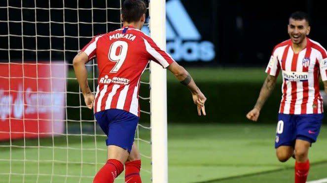 Striker Atletico Madrid, Alvaro Morata (kiri).