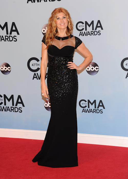 Connie Britton arrives at the 47th annual CMA Awards at Bridgestone Arena on Wednesday, Nov. 6, 2013, in Nashville, Tenn. (Photo by Evan Agostini/Invision/AP)