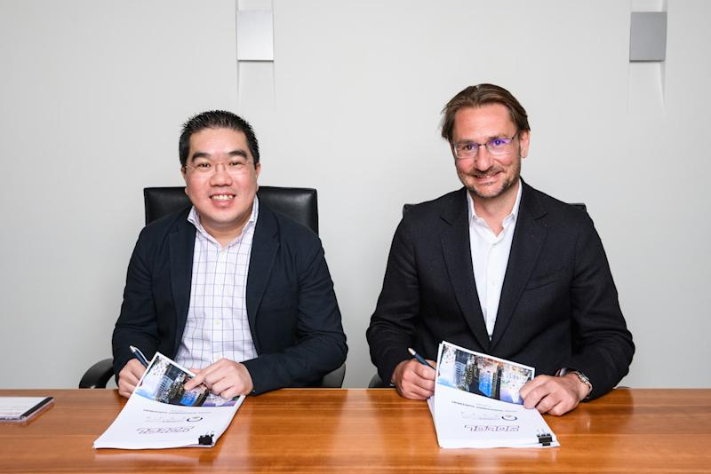 Cornerstone Partners Group chief executive officer Jason Chong (left) and Yotel chief executive officer Hubert Viriot sign the hotel management agreement on Yotel Melbourne. — Image by Cornerstone Partners Group
