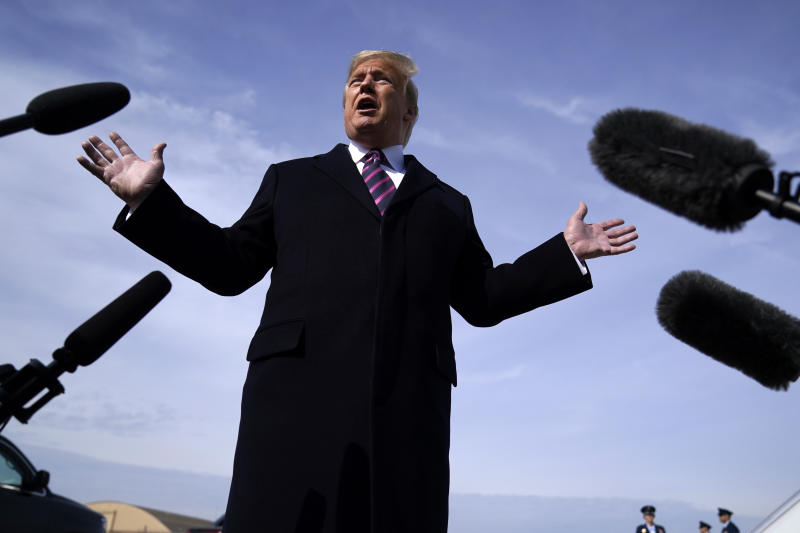 President Donald Trump talks to the media before he boards Air Force One for a trip to Los Angeles to attend a campaign fundraiser, Tuesday, Feb. 18, 2020, at Andrews Air Force Base, Md. (AP Photo/Evan Vucci)