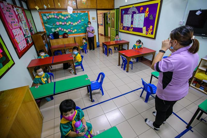 Pre-schoolers are seated accordingly to maintain social distancing while a teacher conducts a class at Mayter Kindergarten in Cheras July 1, 2020. — Picture by Hari Anggara