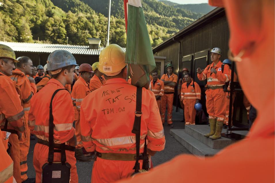 """Miners wait to get in the tunnel prior to the tunnel drilling machine """"Sissi"""" breaks through the last section of the Gotthard Base Tunnel near Faido in the canton of Tessin, Switzerland, Oct. 15, 2010. With 57 kilometers (35-miles) the new St. Gotthard tunnel is the world's longest tunnel. The 13.157 billion Swiss franc (9.6 billion euros, 13.6 billion US dollars) Alptransit project, which is due to be operational in 2017, constitutes the center piece of the New Railway Link through the Alps. Engineers are expected to start up the massive drilling machine - nicknamed Sissi -  at 2 p.m. (1200 GMT; 8 a.m. EDT) so it can chew through the last remaining rock separating the two ends of the 57-kilometer (35.4-mile) Gotthard Base Tunnel.  (AP Photo/Keystone/Martin Ruetschi)  **NO SALES, NO ARCHIVES **"""
