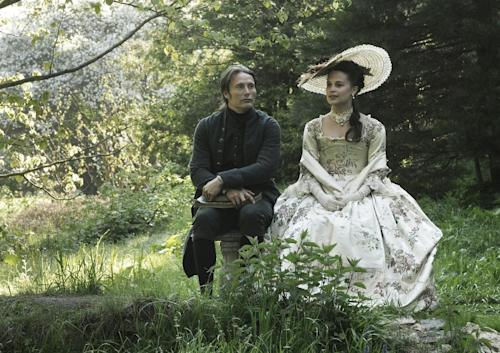 """FILE - This publicity film image released by Magnolia Pictures shows Mads Mikkelsen, left, and Alicia Vikander in a scene from """"A Royal Affair."""" The film was nominated for an Academy Award in the Foreign Language Film category. The 85th Academy Awards will air live on Sunday, Feb. 24, 2013 on ABC. (AP Photo/Magnolia Pictures, File)"""