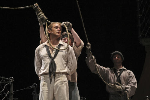 """In this Wednesday, May 2, 2012 photo, Nathan Gunn performs the title roll during the final dress rehearsal of Benjamin Britten's """"Billy Budd"""" at the Metropolitan Opera in New York. (AP Photo/Mary Altaffer)"""