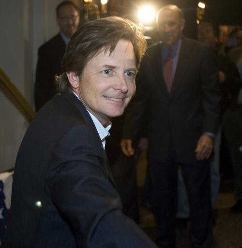 File -- In a Nov. 6, 2006 file photo actor Michael J. Fox greets supporters at a rally for Wisconsin Gov. Jim Doyle in Milwaukee. On his upcoming NBC comedy, Fox will play a newscaster who quits his job because of Parkinson's Disease but returns to work in the show's first episode because a new medical regimen has helped him control many of the disease's symptoms. NBC said Sunday, Jan. 6, 2013, his comedy closely tracks many aspects of Fox's personal life and tries to have fun with an image that has left him an object of pity-fueled admiration.(AP Photo/Morry Gash, File)