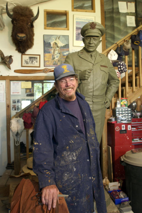 In this May 2003 photo Kansas sculptor Jim Brothers stands in his Lawrence, Kan., studio with the original clay sculpture for a bronze of President and General Dwight D. Eisenhower that was placed in the United States Capitol in June of 2003. Brothers, whose works are part of historical monuments around the country, died Tuesday, Aug. 20, 2013, at his home in Lawrence where he had been in hospice care, according to a funeral director at Warren McElwain Mortuary. He was 72. (AP Photo/Lawrence Journal World, Mike Yoder)