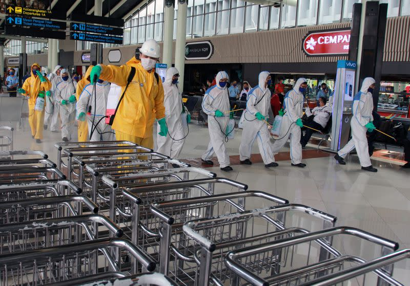 Indonesia to suspend foreign arrivals as coronavirus cases, deaths rise