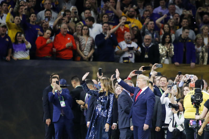 President Donald Trump and first lady Melania Trump attend the NCAA College Football Playoff national championship game Monday, Jan. 13, 2020, in New Orleans. (AP Photo/Gerald Herbert)