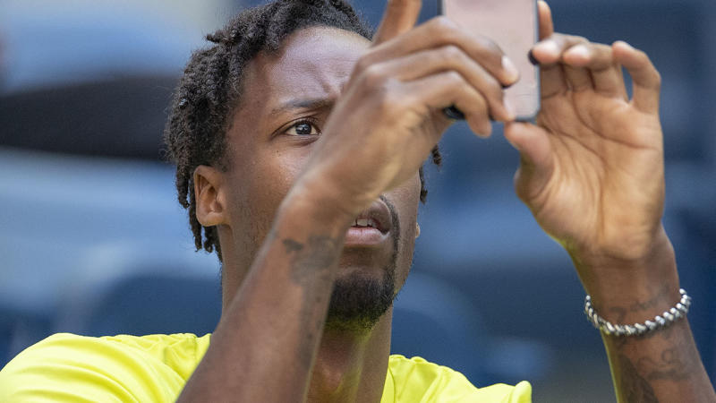 Gael Monfils, pictured here watches on during Elina Svitolina's match at the US Open.