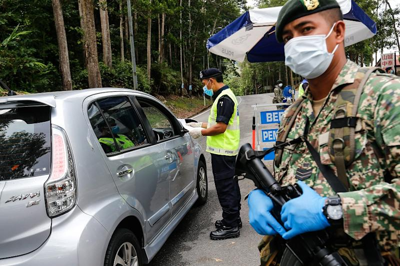 Police and Army personnel join forces to man the roadblocks at the entrance and exits to Balik Pulau at Jalan Tun Sardon in Penang April 10, 2020. — Picture by Sayuti Zainudin