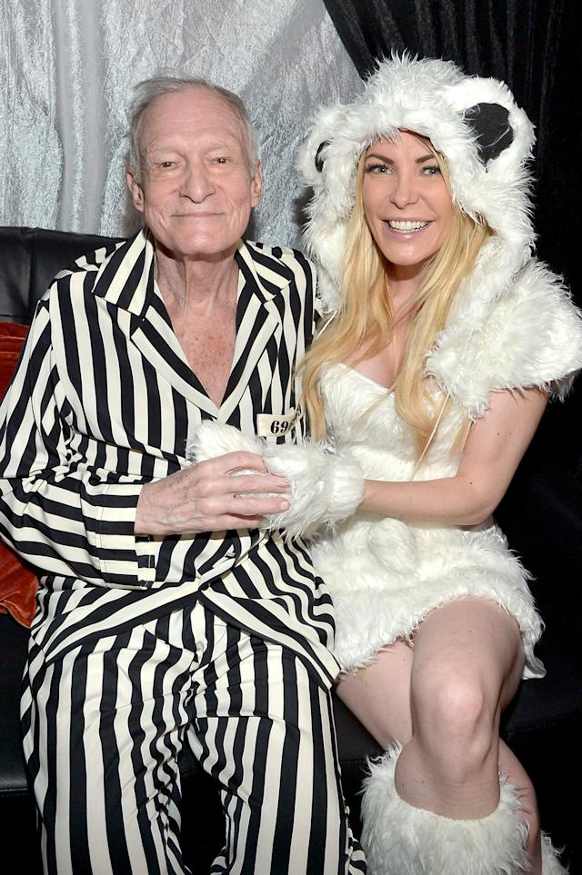 Hgh Hefner and wife Crystal Hefner attend the annual Halloween Party at the Playboy Mansion on Oct. 24, 2015. (Charley Gallay via Getty Images)
