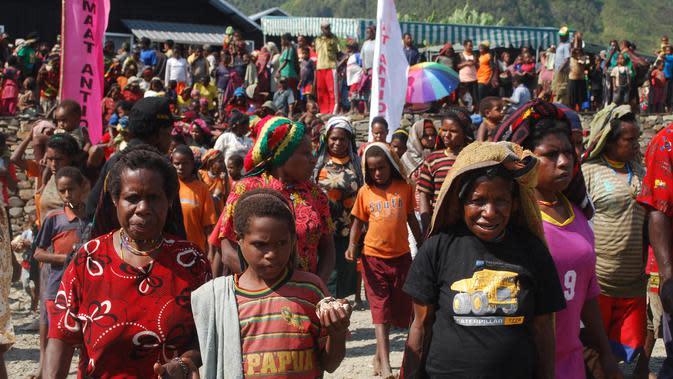 Ilustrasi masyarakat Papua. (Liputan6.com / Katharina Janur)