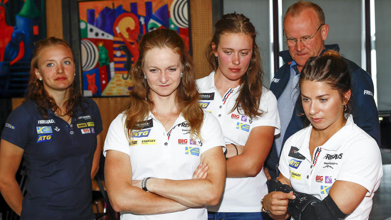 Swedish biathlon athletes look on in disappointment. (Photo by PER DANIELSSON/AFP/Getty Images)