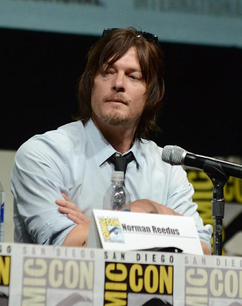 """Norman Reedus participates in """"The Walking Dead"""" panel on Day 3 of Comic-Con International on Friday, July 19, 2103, in San Diego. (Photo by Jordan Strauss/Invision/AP)"""