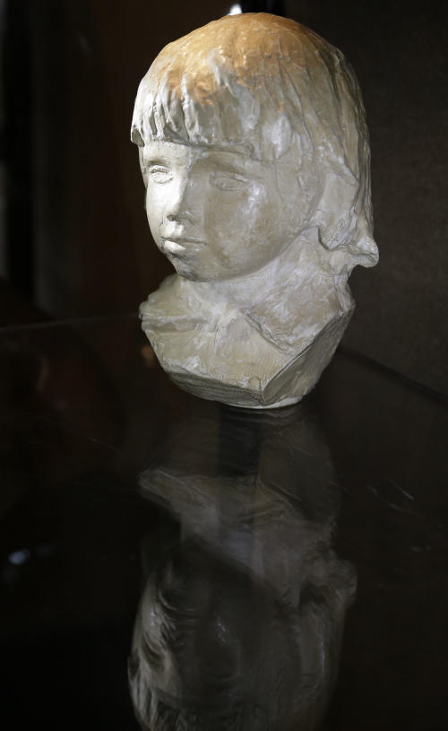 This photo made Friday, Aug. 16, 2013, shows artist Pierre-Auguste Renoir's bust of his son Coco dated 1907-08, on display in Dallas. The French artist's personal archive will be up for sale in New York City in September. (AP Photo/LM Otero)