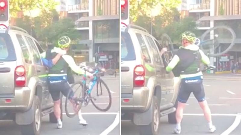 A brawl has broken out between a cyclist and driver while waiting at a red light. Source: Instagram - dt_tran