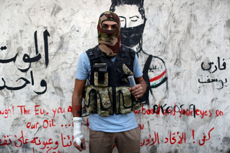 FILE PHOTO: Hussein Karim Hashem, an Iraqi demonstrator, poses for a photograph during the ongoing anti-government protests in Baghdad