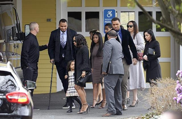Shayanna Jenkins Hernandez, front, arrives with their daughter Avielle at the funeral of Aaron Hernandez. (AP)