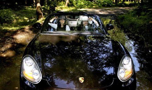 In this picture taken on Friday, May 24, 2013, two Iranian women ride in a Porsche, in Noor forest, northern Iran. (AP Photo/Ebrahim Noroozi)