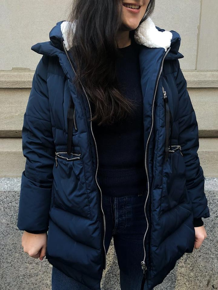 "<p>""I'm a California girl living in New York City; when it comes to <a href=""https://www.popsugar.com/fashion/Best-Puffer-Coats-36124584"" class=""ga-track"" data-ga-category=""Related"" data-ga-label=""https://www.popsugar.com/fashion/Best-Puffer-Coats-36124584"" data-ga-action=""In-Line Links"">Winter coats</a>, I don't mess around. Recently, I've been in the market for a new style. There are so many <a href=""https://www.popsugar.com/fashion/Best-Statement-Coats-45535201"" class=""ga-track"" data-ga-category=""Related"" data-ga-label=""https://www.popsugar.com/fashion/Best-Statement-Coats-45535201"" data-ga-action=""In-Line Links"">fun, fashion-forward silhouettes</a> this season, but I never actually buy them, because I'm worried they won't keep me warm. So here I was, minding my own business, when I happened upon Arielle Charnas aka Something Navy's Instagram Story. She was talking about some <a href=""https://www.popsugar.com/fashion/best-coats-45621663"" class=""ga-track"" data-ga-category=""Related"" data-ga-label=""https://www.popsugar.com/fashion/Best-Coats-2019-45621663"" data-ga-action=""In-Line Links"">coat</a> that she was wearing and loving and casually mentioned it was from Amazon. My ears perked up, and I started doing a little more research.</p> <p>Known colloquially as the 'Amazon Coat' or the 'Upper East Side Mom Coat,' this <a href=""https://www.popsugar.com/buy/Orolay-Women-Thickened-Down-Jacket-408068?p_name=Orolay%20Women%27s%20Thickened%20Down%20Jacket&retailer=amazon.com&pid=408068&price=140&evar1=savvy%3Aus&evar9=46077215&evar98=https%3A%2F%2Fwww.popsugar.com%2Fsmart-living%2Fphoto-gallery%2F46077215%2Fimage%2F46077349%2FOrolay-Women-Thickened-Down-Jacket&list1=shopping%2Camazon%2Cgift%20guide%2Ceditors%20pick%2Cproduct%20reviews&prop13=api&pdata=1"" rel=""nofollow"" data-shoppable-link=""1"" target=""_blank"" class=""ga-track"" data-ga-category=""Related"" data-ga-label=""https://www.amazon.com/Orolay-Womens-Thickened-Jacket-Green/dp/B00HHOXT0A/ref=sr_1_1_sspa?ie=UTF8&amp;qid=1548433427&amp;sr=8-1-spons&amp;keywords=orolay+women%27s+thickened+down+jacket&amp;psc=1&amp;smid=A2L41BJLE6LBDZ"" data-ga-action=""In-Line Links"">Orolay Women's Thickened Down Jacket</a> ($140) is a New York City staple. And when I say that, I'm not exaggerating: in the last week I've seen around 20 women wearing this coat, and I saw three women wearing it just in my commute this morning. The origin of the coat is slightly unclear; it apparently started with a teacher, and soon caught on to every mom on the Upper East Side of Manhattan, before trickling its way downtown to the POPSUGAR offices and my neighborhood. Everyone I meet asks one question, 'Is it worth buying?,' and I can answer with an emphatic yes.</p> <p>I understand why moms wanted to wear this coat. They want something that's got big pockets, that can withstand juice spills and <a href=""https://www.popsugar.com/fashion/Best-Cheap-Coats-2019-45658116"" class=""ga-track"" data-ga-category=""Related"" data-ga-label=""https://www.popsugar.com/fashion/Best-Cheap-Coats-2019-45658116"" data-ga-action=""In-Line Links"">doesn't feel too precious</a>. Plus, it's got a big, thick, shearling-lined hood that doesn't budge and keeps you toasty, even through particularly difficult windchill. And also, this <a href=""https://www.popsugar.com/fashion/Best-Faux-Fur-Coats-43915942"" class=""ga-track"" data-ga-category=""Related"" data-ga-label=""https://www.popsugar.com/fashion/Best-Faux-Fur-Coats-43915942"" data-ga-action=""In-Line Links"">coat is warm</a>. Like, actually warm. I classify my coats as either a 40-degree coat or a 20-degree coat, and this is definitely a 20-degree coat. I don't know how, but it's made of real down. I've spilled matcha on it, and it slides right off. As if that wasn't enough, the coat has an oversize parka style that looks much more expensive than it is; someone asked me if it was designer, and I was proud to say that I got it on Amazon."" - India Yaffe, editorial assistant, Shop </p>"