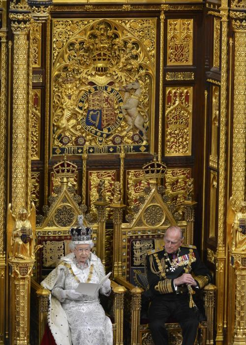 Britain's Queen Elizabeth delivers her speech during the State Opening of Parliament at the House of Lords, alongside Prince Philip in London Wednesday May 8, 2013. The State Opening of Parliament marks the formal start of the parliamentary year, the Queen delivered a speech which set out the government's agenda for the coming year. (AP Photo/Toby Melville, Pool)