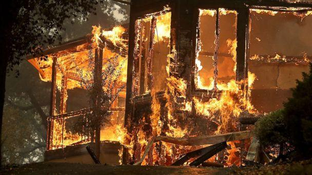 PHOTO: Flames consume a home as an out of control wildfire moves through the area, Oct. 9, 2017, in Glen Ellen, California. (Justin Sullivan/Getty Images)