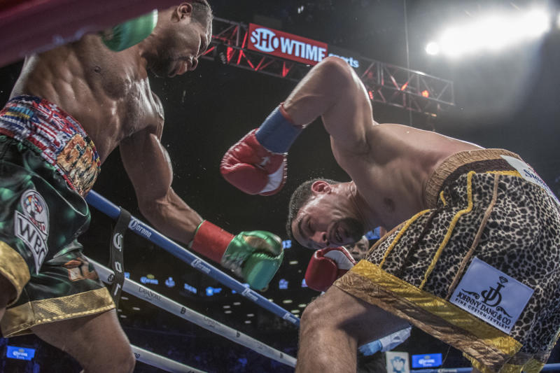 NEW YORK, NY - SEPTEMBER 08: Shawn Porter ( green trunks ) defeats Danny Garcia ( yellow pattern trunks ) by Unanimous Decision in their WBC Welterweight Title fight at Barclays Center on September 8, 2018 in New York City. (Photo by Bill Tompkins/Getty Images)