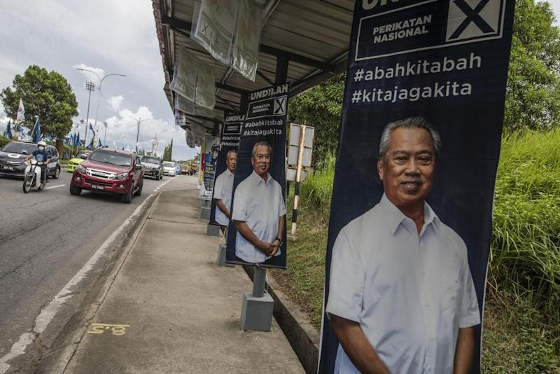 Election poster featuring Perikatan Nasional chairman Tan Sri Muhyiddin Yassin are seen in Keningau, Sabah September 24, 2020. — Picture by Firdaus Latif